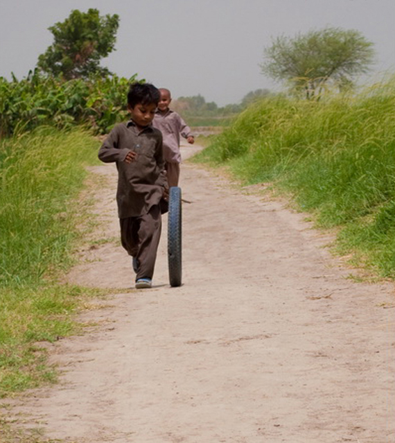 boy with tyre The Real Beauty of Pakistan by Furqan Riaz